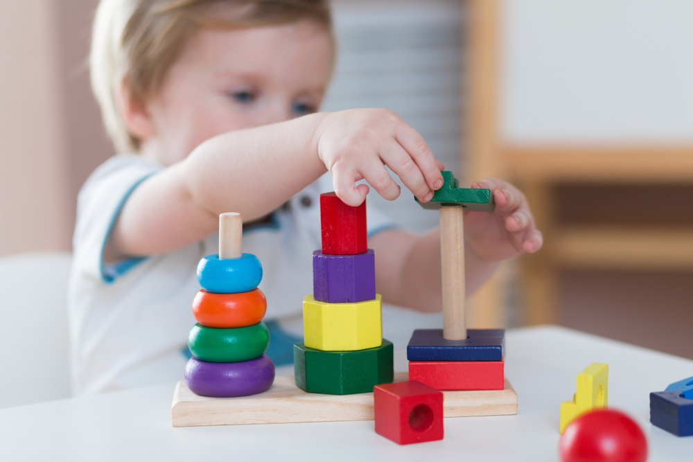 Two,Years,Old,Child,Boy,Playing,With,Wooden,Colorful,Blocks